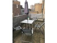 Outside Table with umbrella & 4 chairs