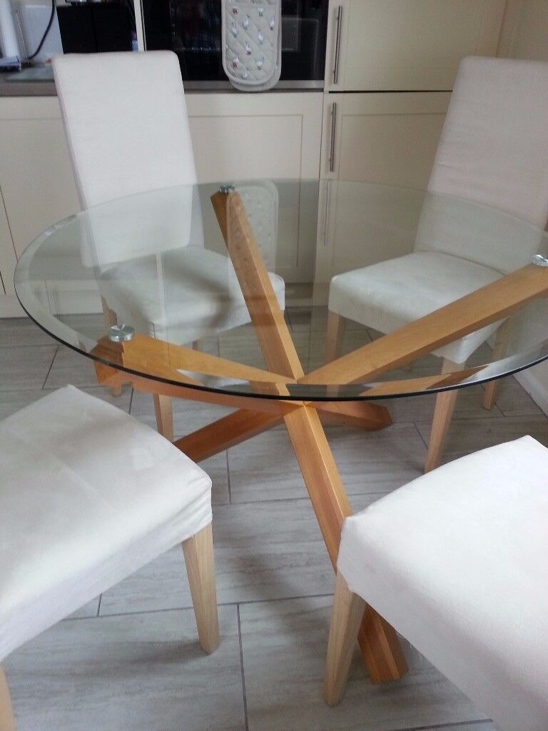 42 Round Glass Dining Table With 4 Cream Chairs For Sale