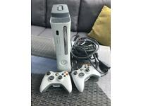 Xbox 360 and 2 Controllers