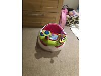 Baby chair with toys on it. Ideal for letting baby sit up and play
