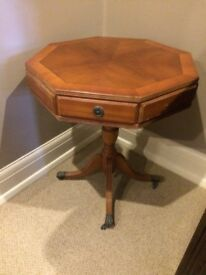 hexagonal drum table with claw feet and castors