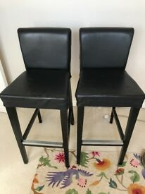 Two leather stools