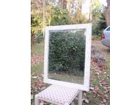 Decorative carved wooden mirror with bevelled glass in cream painted finish