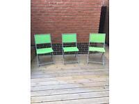 Green folding garden chairs