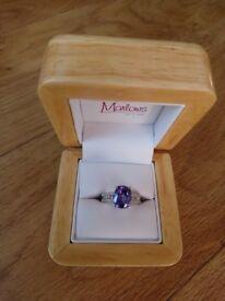 White gold Tanzanite and diamond stunning ring only worn occasionally.