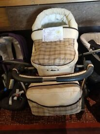 Pram with carry cot, covers, bag and rain cover