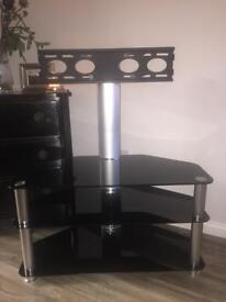 Tv stand with raised bracket