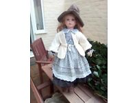 I have a doll for sale its a bout 2ft tall you can by the picture it's in good condi