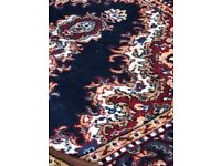 15 multi sized Persian rugs.