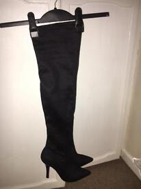 Black Faux-Suede knee high boots.