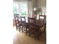 Solid oak dining table and 8 chairs £375.