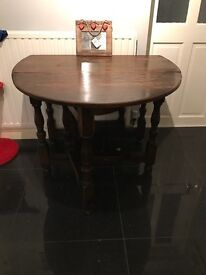 Dark wood drop leaf dining table with 3 chairs