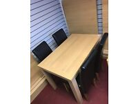 Oak effect Table and 4 Black leather chairs