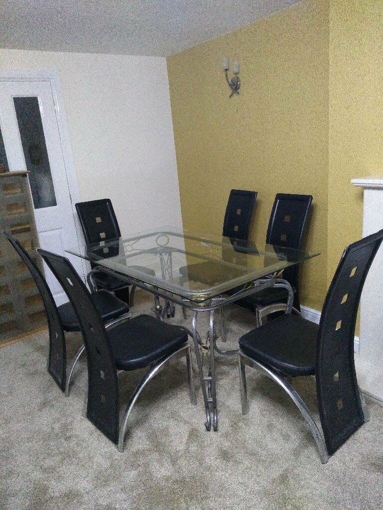 Glass Dining Table With 6 Black/Chrome Chairs