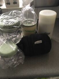 Baby bundle includes Nutri bullet, tommee tippee bottle carrier and bottle/ food warmer.