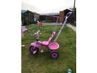 Pink and purple push along 2 in 1 trike