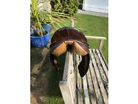 Brown leather saddle. USED