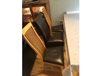 6 oak dining chairs- brown faux leather