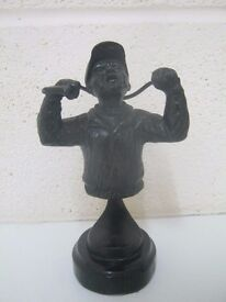 Bronze figure of a golfer in anguish after missing a putt