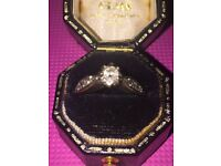 White gold and diamond engagement ring size K. Large center stone 3smaller diamonds either side
