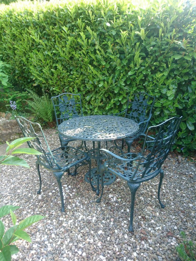 Green plastic coated patio furniture set