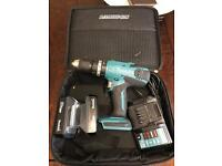 Makita combi hammer drill with 2 batteries