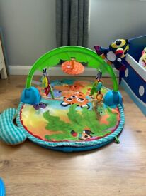 Baby play mat with moving parrot going side to side