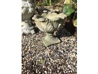 Attractive planting stone pot on base with leaf outside pattern.