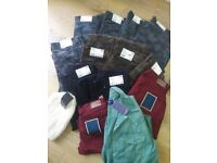 12 pair of trousers, 1 shirt and 1 hat (all new with tags)
