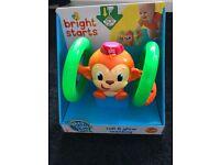 Bright Starts Lights Baby Roll & Glow Monkey