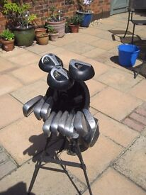 Set of golf clubs with carry bag and stand and accessories