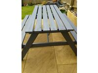 Wooden picnic table with bench