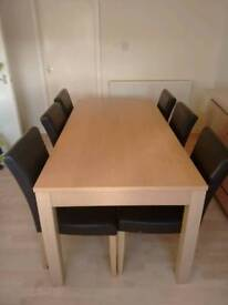 Light oak dining table and 6 brown leather chairs