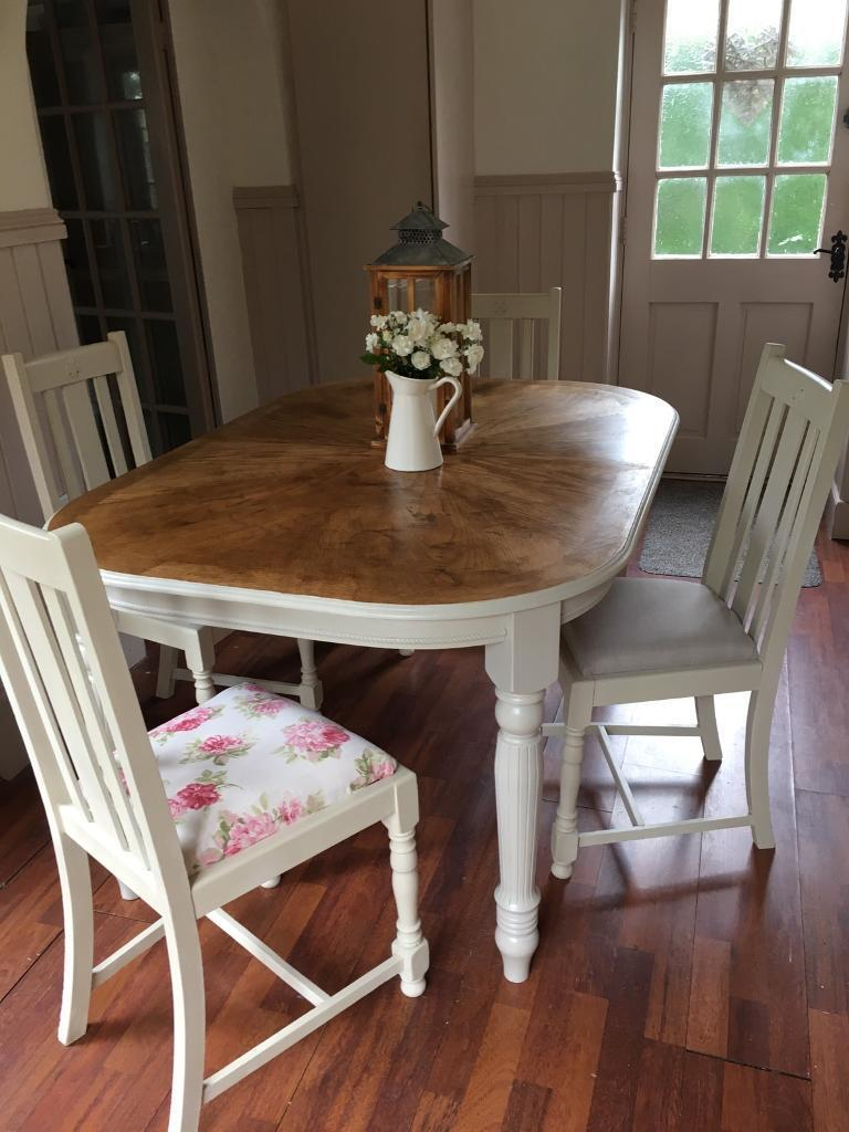 Shabby chic extending table and chairsin Swadlincote, DerbyshireGumtree - Shabby chic spray painted chairs in a antique cream furniture by crown x4New reupholstered chairs in floral fabric and grey linen fabricTable has been sanded and waxed , table legs come off for easy transportThere is also a extension that fits in the...