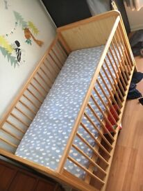 Cot bed with brand new mattress and sheets £50