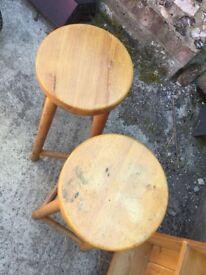 Two round pine breakfast bar stools