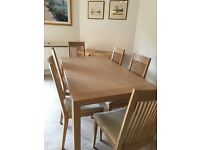 Solid wood dining table with 8 high backed chairs