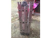 Metal extending ladders