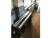 Roland F 50 Digital Piano with wooden stand and foot pedal