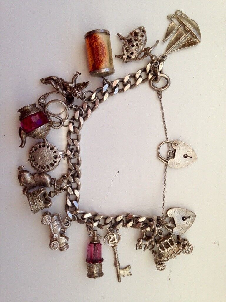 Solid Silver Charm Bracelet, with lots of charms