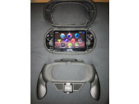 Sony PS Vita 16GB (Wi-Fi + 3G) + Charger + Travel Case + Power Grip
