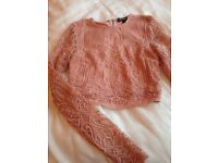 like new long sleeved pink lace top