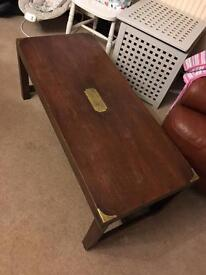 Solid wood coffee table with brass corner plates