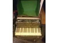 Galanti accordion still in original case in working condition has all its keys and original strap