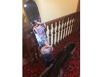 Woman's snowboard, bindings and bag