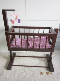 Doll's wooden rocking crib with mobile and bedding, ideal toy or collector's item