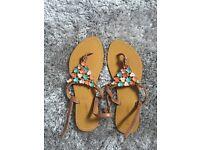 Love label flower jewelled flip flop sandals size 4