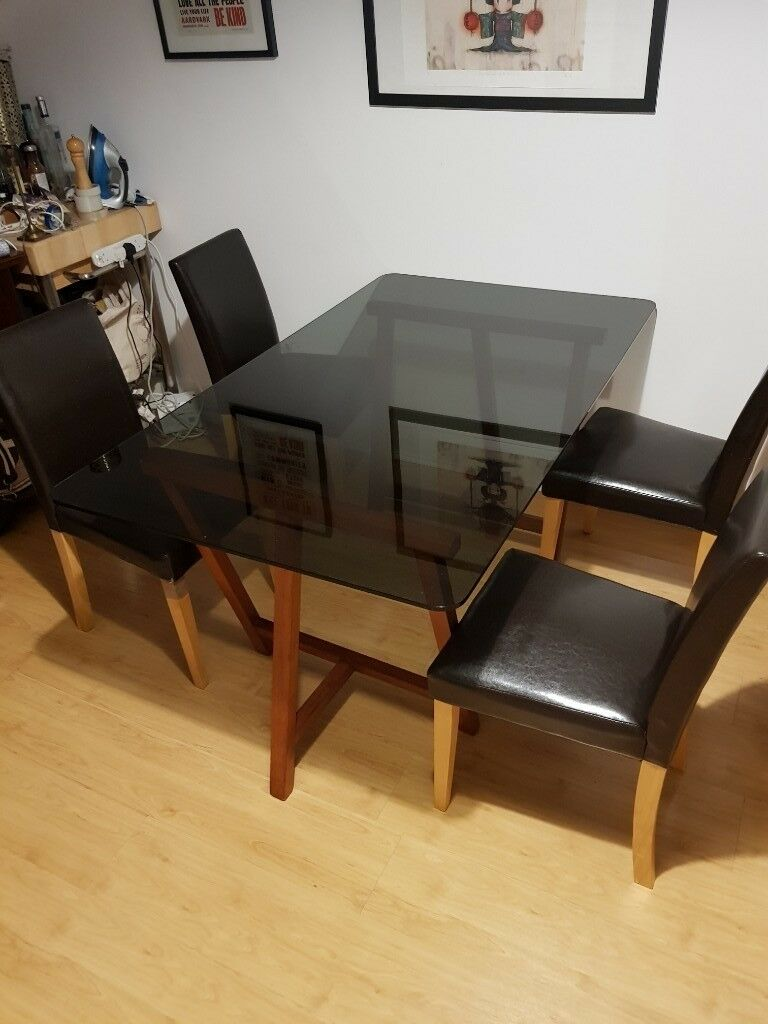 Handmade Black Tempered Glass Easle Style Dining Table And