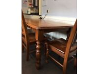 Large hardwood table and 4 matching dining chairs, excellent quality