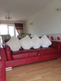 3 seater red sofa and matching two seater available for quick sale